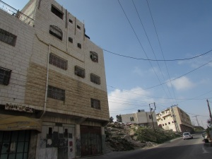 Soldiers delivered a stop work order to the owner of the building on the left, one building away from the Al Rajabi building on the right.